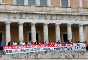 "Parliamentarians of the anti-bailout radical leftist SYRIZA party hold a banner in front of the parliament in Athens, July, 16, 2013, during a 24-hour general strike in Greece. The banner reads ""Let's fire the government. No lay-offs in the state and private sector""."