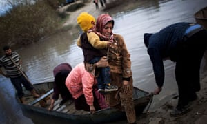 Syrian refugees cross the Orontes river to Hacipasa village, Turkey