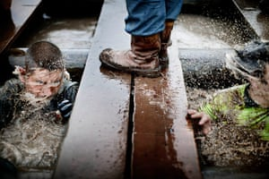 Tough Guy - Weekend: image showing man's feet in boots standing on some wet planks