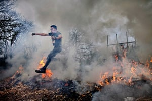 Tough Guy - Weekend:  A man jumps through a fire before having to wander through a muddy lake.