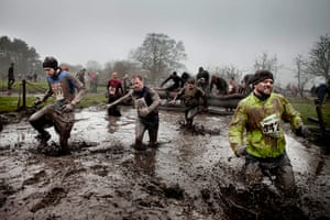 Tough Guy - Weekend: Men run through muddy canal