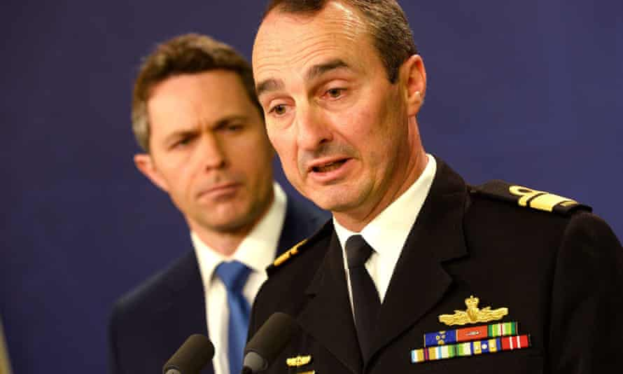 Commander of border protection command, rear admiral David Johnston, Royal Australian Navy, and home affairs minister Jason Clare, speak to the media during a press conference in Sydney on 17 July 2013.