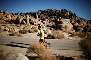 FTA: Lucy Nicholson: Carlos Alberto Gomes De Sa of Portugal, right, runs with his pacesetter on