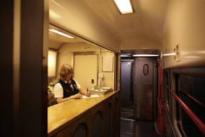 Night Riviera: A staff member at work in the buffet car