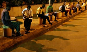 Guinean students study at G'bessi airport in the capital, Conakry