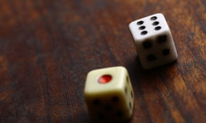 Two dice displaying on a wooden surface