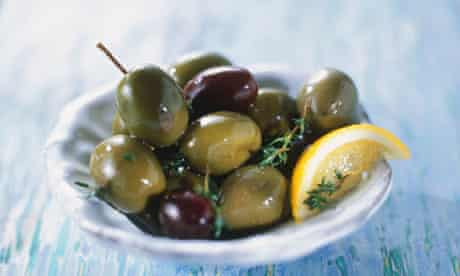 Small plate of green and black olives