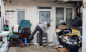 A Newham Council planner inspects an apartment built in the back garden of a house