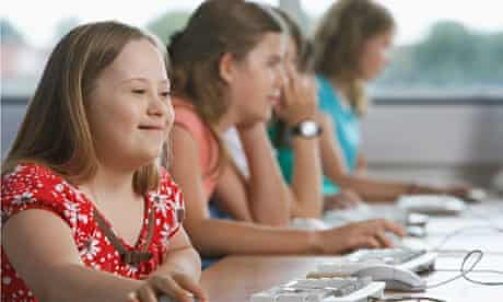 A girl with Down's syndrome using a computer