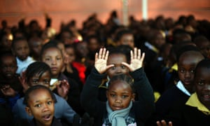 Today is Nelson Mandela's 95th birthday so children at the Denver Primary School in Johannesburg, South Africa are singing happy birthday in celebration and offering prayers for the former president's return to health.