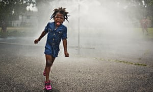 Feeling hot hot hot? Myirale Johnson, 5, cools off in a sprinkler at the aptly named Cool Spots Franklin Square in Milwaukee. Cool Spots operate on days when temperatures are predicted to be above 29 degrees celsius.