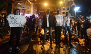 People protest near the residence of Rio de Janeiro's governor against the spending of public resources on events such as the World Cup and the Pope's visit.