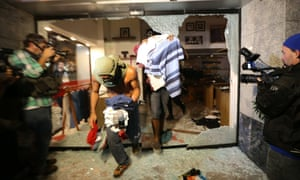 Demonstrators looted stores and set fires as the protest turned violent.