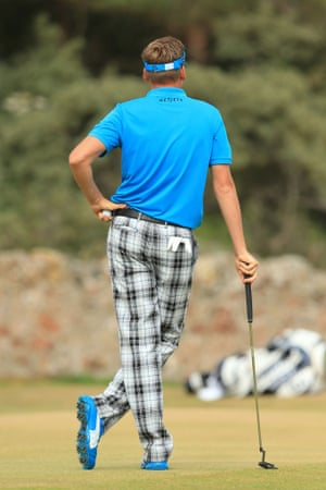 Fancy pants! England's Ian Poulter pauses for thought on the first day of the 2013 Open Championship at Muirfield Golf Club in East Lothian.