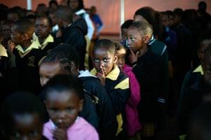 Mandela's birthday: Pupils at the Denver Primary School in Johannesburg, South Africa, gesture