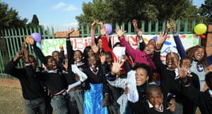 Mandela's birthday: Teachers and students from The Lukho Lwen School hold cards in Soweto