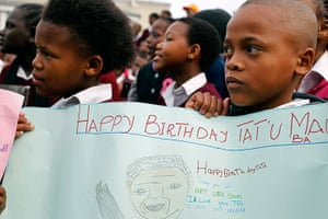 Mandela's birthday: Children hold up a poster at a school in Cape Town