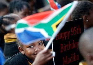 Mandela's birthday: Children hold placards at a township school in Atteridgeville near Pretoria