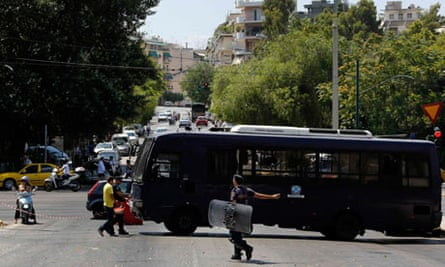 Police block a street in Athens