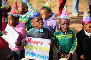 Mandela's birthday: Children wear hats outside the Medi-Clinic Heart Hospital, where Mandela is