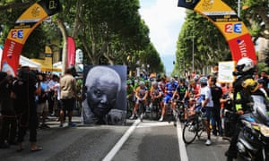 The peloton marks the 95th birthday of former South African President Nelson Mandela before they begin stage eighteen of the 2013 Tour de France from Gap to l'Alpe d'Huez.