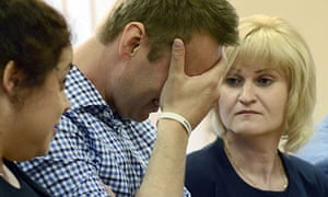Alexei Navalny reacts as the judge sentences him to five years in jail for embezzlement