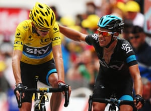Two's company - Chris Froome (L) of Great Britain and Team Sky Procycling, and team mate Richie Porte of Australia cross the finish line together at the end of stage eighteen of the 2013 Tour de France.