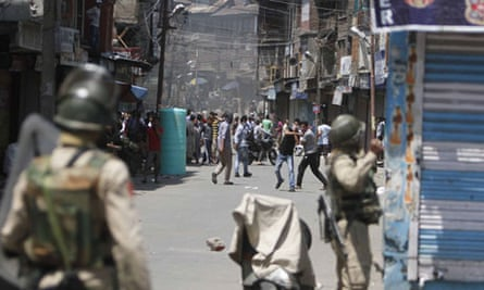 Protesters throw stones at Indian police during a protest in Srinagar