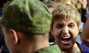 A woman protests after opposition leader Alexei Navalny was sentenced to 5 years in a penal colony