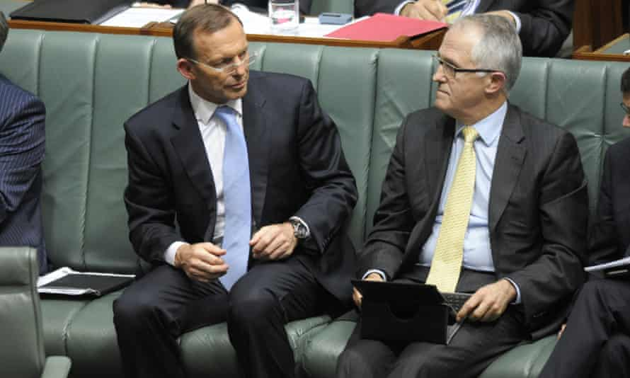 Tony Abbott speaks to Malcolm Turnbull during Question Time.