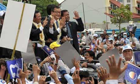 Sam Rainsy (with glasses) greets supporters on his return to Phnom Penh.