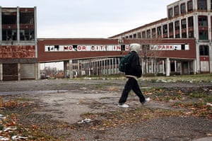 motor city blues: A person walks past the remains of the Packard Motor Car Company