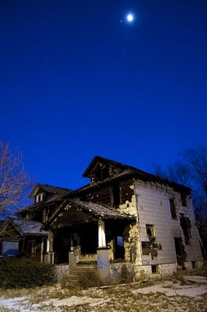 motor city blues: The moon and the planet Jupiter hover over a burned out house on Wagner Str