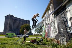 motor city blues: Artists paint the walls of Imagination Station, a house across from Detroit