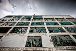 motor city blues: The broken windows of an abandoned factory