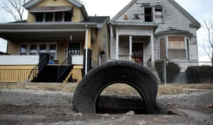 motor city blues: A tire sits on a storm drain as a replacement for a cast iron grate