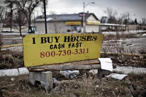 homes: Shuttered and repossessed homes line the streets of a middle class area of