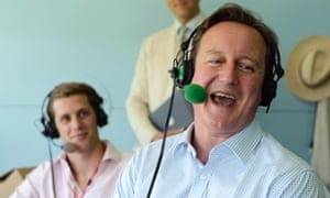Prime Minister David Cameron laughs as he is interviewed on BBC's Test Match Special during the lunch break of the second Ashes cricket test match between England and Australia at Lords.