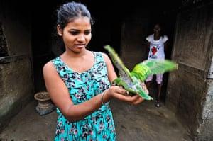 Indian Slavery: Elaina Kujar, 20, in her home in Dolahat tea estate