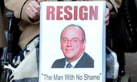 placards calling NHS boss David Nicholson 'The Man With No Shame