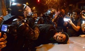 Demonstrator detained by riot police, Rio de Janeiro, 18/7/13