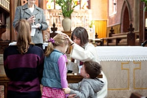 CofE: Rev Catherine Grylls blesses a child