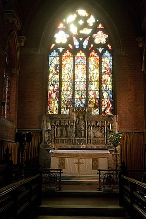 CofE: The altar and stained glass window