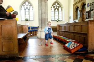 CofE: A child plays during the ser