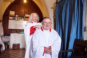 CofE: John helps George with his cassock