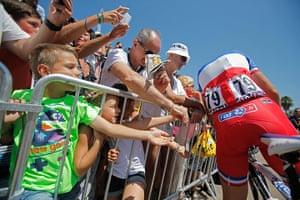 Tour de France stage 3: Young fans reach out to get an autograph of Arthur Vichot