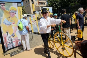Tour de France stage 3: A disguised man holds a bike in Ajaccio