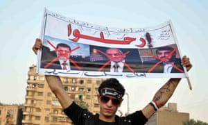 Egyptian opposition supporters take part in a protest demanding that Egyptian President Mohamed Mursi resign.
