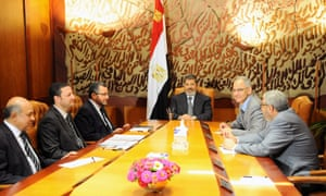 Egyptian President Mohamed Morsi meeting his prime Hisham Qandil (third left) and other members of his cabinet on Monday.