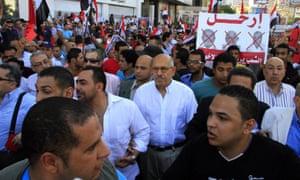 Mohamed ElBaradei  joins protesters during a march against Egyptian President Mohamed Morsi on Sunday.